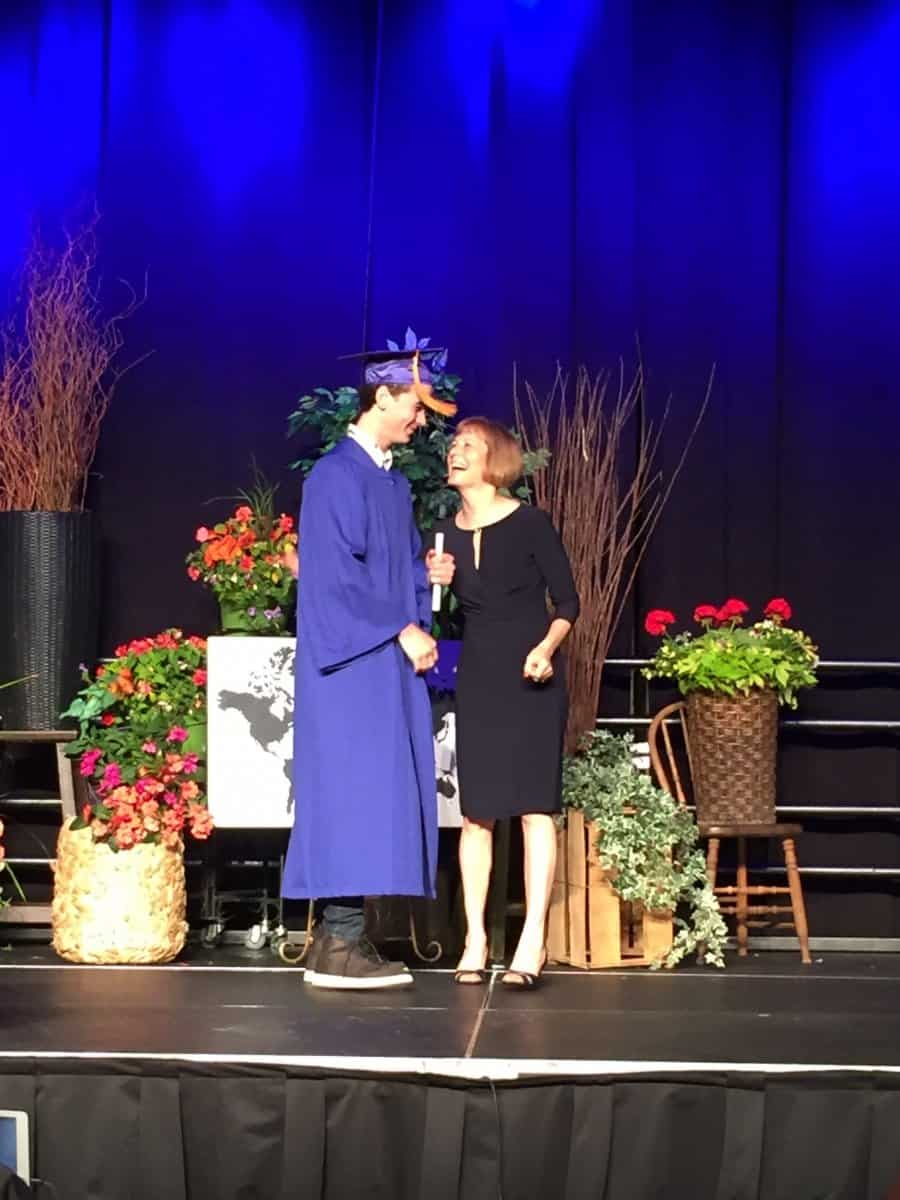 Theodore on stage during graduation